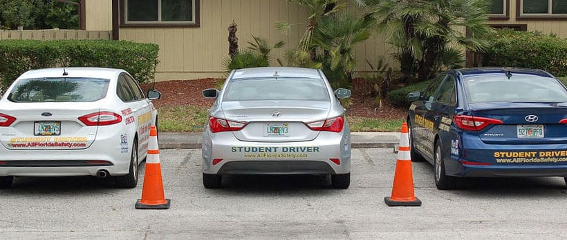 3 student driver cars parked at All Florida Safety Institute