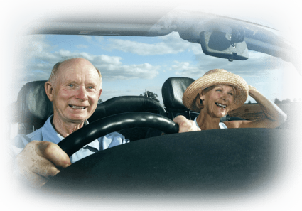 Seniors smiling taking driving school classes