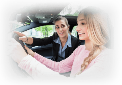 Instructor teaching student driver for license